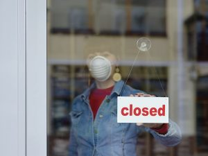 woman in closed shop with mask - your text closed